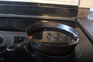 Fill the skillet about halfway full of water.